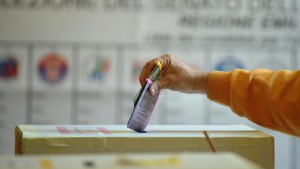 Italy's voter casts their ballots at a p